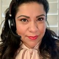 Female customer service member wearing headset and smiling