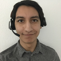 Male customer service member wearing headset and smiling